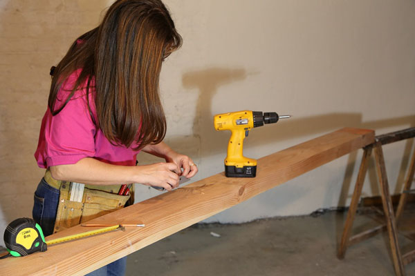 woman using cordless drill
