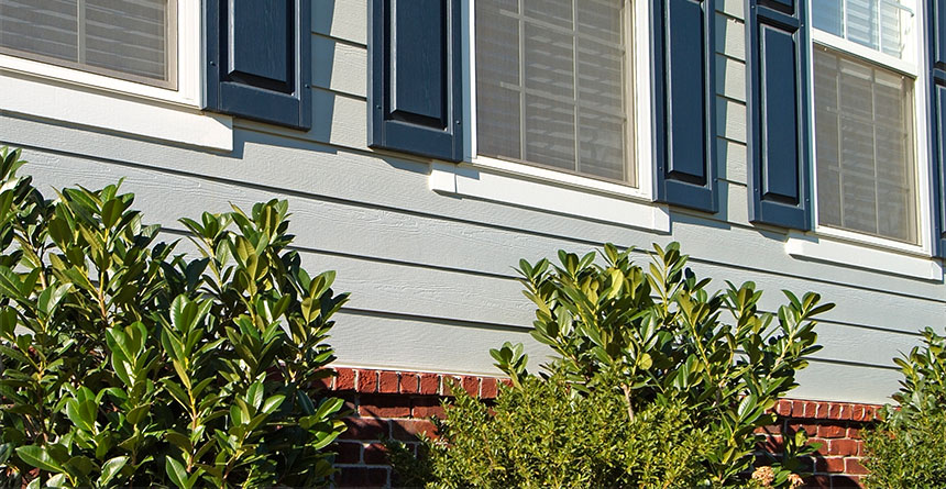 hardie plank lap siding with blue shutters